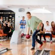 Man Bowling With Friends Cheering in Club — Photo