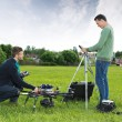 Engineers Working On UAV Helicopter in Park — Stock Photo