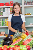 Happy Saleswoman Working At Supermarket — Stock Photo