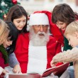 Children And SantClaus Reading Book — Stock Photo #34420735