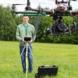 Technician Flying UAV Helicopter — Stock Photo