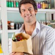 Man With Vegetable Bag In Grocery Store — Stock Photo