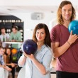 ������, ������: Man And Woman Holding Bowling Balls in Club