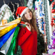 Woman Carrying Shopping Bags At Christmas Store — Stock Photo