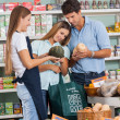 Couple Shopping Vegetables While Saleswoman Assisting Them — Stock Photo