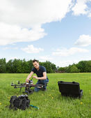 Technician Preparing Multirotor Helicopter — Photo