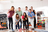 Woman Bowling While Friends Motivating in Club — Stock Photo