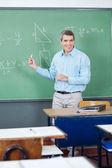 Male Teacher Teaching Mathematics On Board — Stock Photo