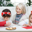Senior Woman With Siblings Writing Letters To Santa Claus — Φωτογραφία Αρχείου