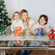 Happy Children And Mother With Christmas Presents — Photo