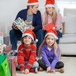 Children With Parents At Home During Christmas — Stock Photo