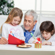 Grandfather Assisting Children In Writing Letters To SantClaus — Stock Photo #34857159