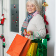 Senior Woman Carrying Shopping Bags At Home — Stock Photo