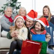 Stock Photo: Children And Father With Gifts During Christmas