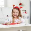 Happy Girl Writing Letter To Santa Claus — Stock Photo