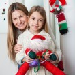 Mother With Daughter Holding Santa Toy At Home — Photo