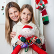 Mother With Daughter Holding Santa Toy At Home — Stok fotoğraf