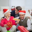 Stock Photo: Happy Family With Christmas Gifts