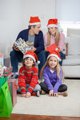 Children With Parents At Home During Christmas — Stockfoto