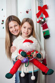 Mother With Daughter Holding Santa Toy At Home — Stock Photo