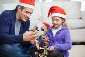 Father And Daughter Looking At Christmas Decorations — Stockfoto