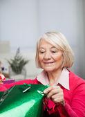 Senior Woman Looking In Bag — Stock Photo