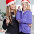 Girl With Mother Decorating Christmas Tree — Foto Stock