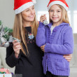 Girl With Mother Decorating Christmas Tree — Photo