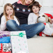 Loving Mother With Children During Christmas — Stockfoto