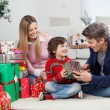 Happy Family With Christmas Gifts — Stockfoto