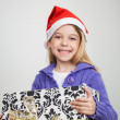 Happy Girl Holding Christmas Gift — Stock Photo