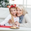 Grandmother And Girl Smiling During Christmas — Stock Photo