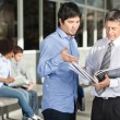 Teacher Holding Books While Discussing With Student On Campus — Stock Photo