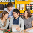 College Friends With Digital Tablet Studying In Library — Stock Photo