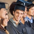 Happy Man Standing With Students On Graduation Day In College — Stock Photo