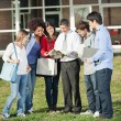 Professor Teaching Lesson To Students On College Campus — Stock Photo