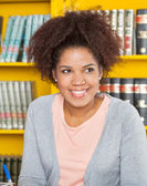 Woman Looking Away While Smiling In University Library — Stock Photo