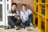 Students With Digital Tablet Sitting In University Library — Stock Photo