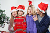 Family At Home During Christmas — Stockfoto