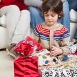 Boy Looking At Christmas Presents — Stock Photo #34920145
