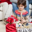 Boy Looking At Christmas Presents — Stock Photo #34920145