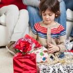 Boy Looking At Christmas Presents — Stock Photo