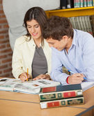 College Friends Studying Together At Library — Stock Photo