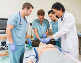 Doctor Instructing Nurses In Hospital Room — Stock Photo