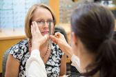 Female Optician Measuring Woman's Eyeglasses — Stock Photo