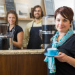 Customer Holding Coffee Cup With Workers At Café — Stock Photo #35194367