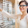 Happy Woman Buying Glasses At Optician Store — Stock Photo