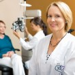 Confident Eye Doctor With Colleague Examining Patient — Foto de Stock