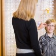 Stock Photo: Mother Trying Spectacles On Son At Shop