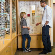 Optometrist And Boy Communicating In Store — Stock Photo